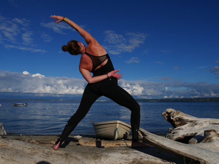 Reverse Warrior pose on the beach at Whidbey Island