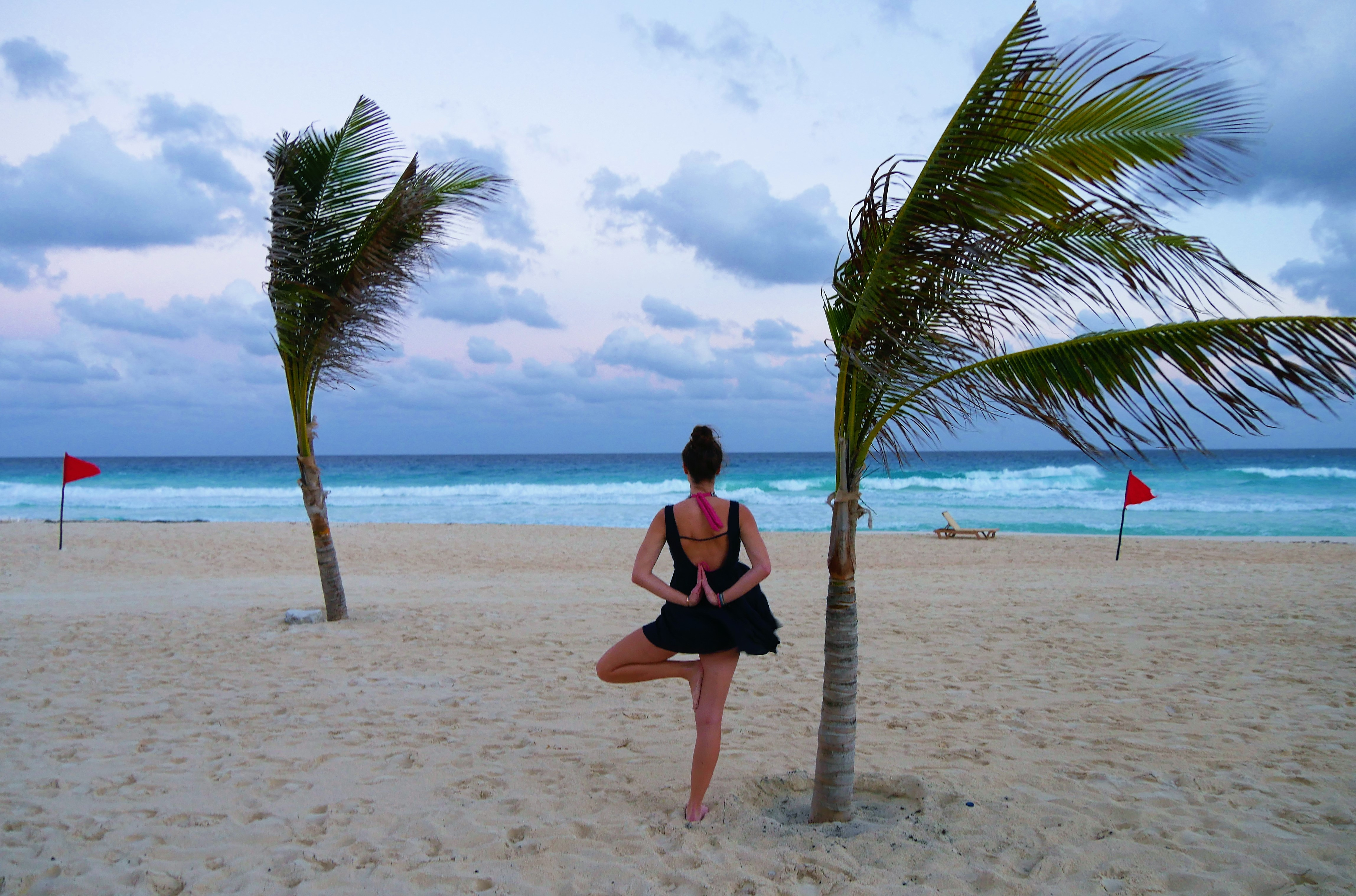 Tree pose on the beach in Cancun, Mexico