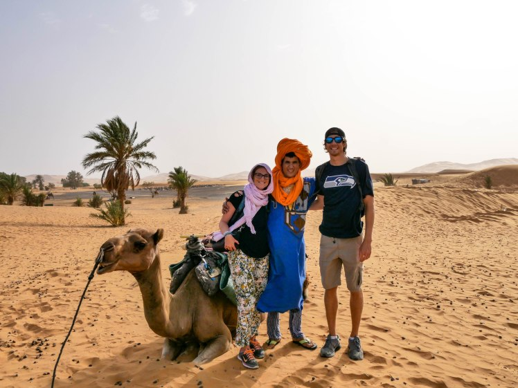 Travel couple with Morocco Camel Trekking guide Mohammed