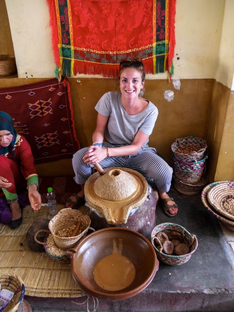 Travel girl making aragan butter in Morocco