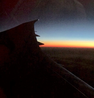 Sunrise over the wing of an airplane