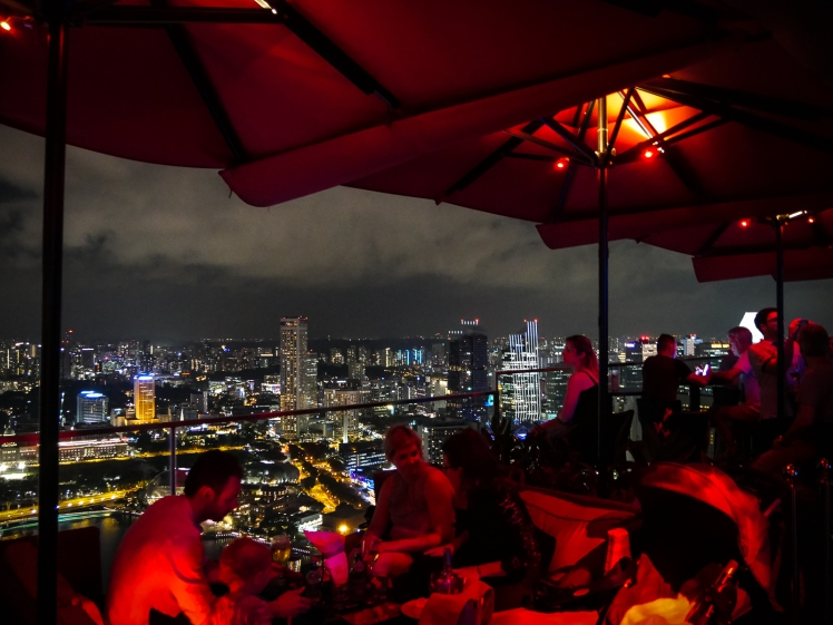 Rooftop bar Ce La Vie at the top of the Marina Bay Sands hotel in Singapore at night on the 57th floor