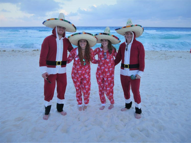 Family Christmas pajamas on beach in Mexico