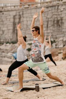 Beach yoga class Warrior I pose