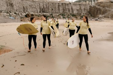 Girls heading out to surf in A Coruna, Spain