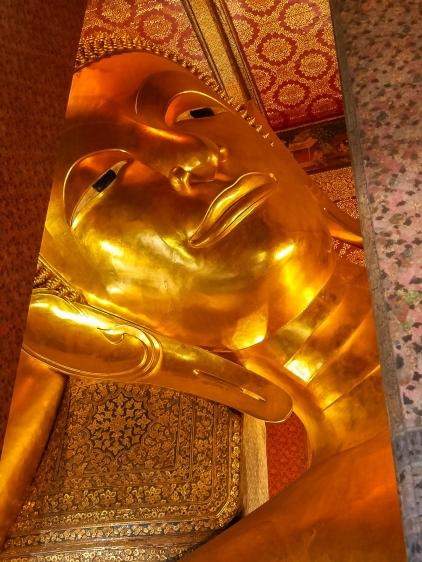 Head of the 150+ foot long reclining Buddha at Wat Pho in Bangkok