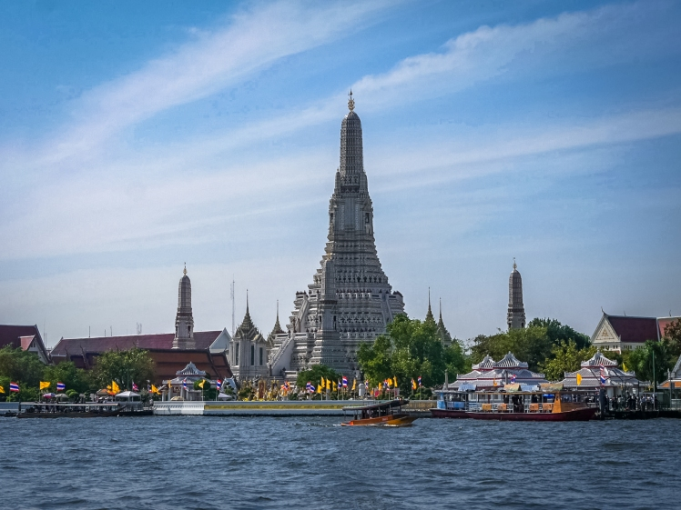 View of Wat Arun from the shuttle boat on the Chao Phraya RiverView of Wat Arun from the shuttle boat on the Chao Phraya River