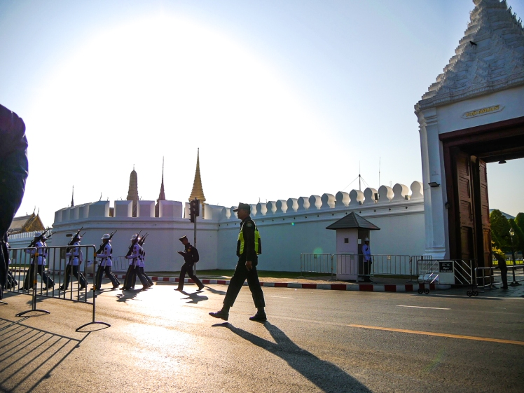 Guards marching outside the Grand Palace before it opens at 8:30 a.m.