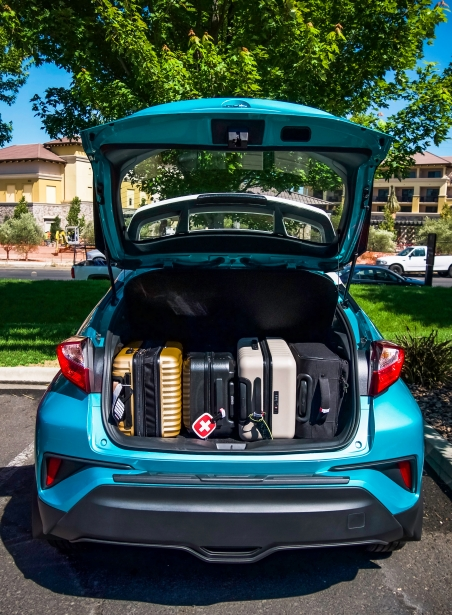Toyota C-HR with suitcases in trunk