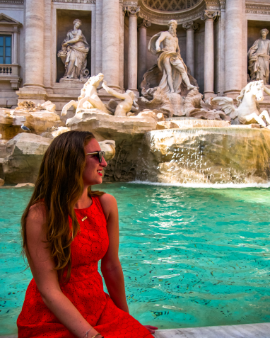 Sitting on the ledge of the Trevi Fountain