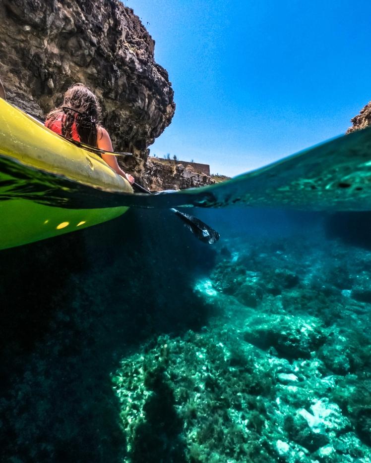 Underwater overwater kayak shot