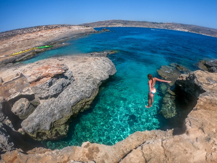 Cliff jumping in Comino