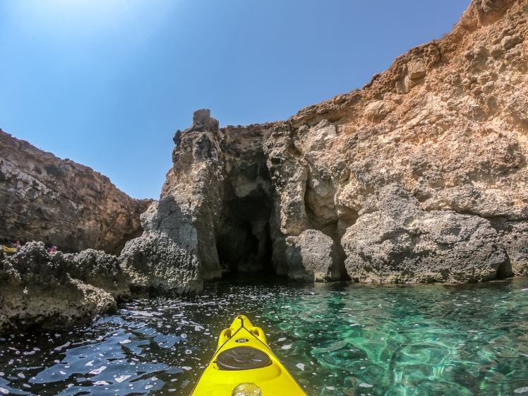 Kayaking into caves in Comino