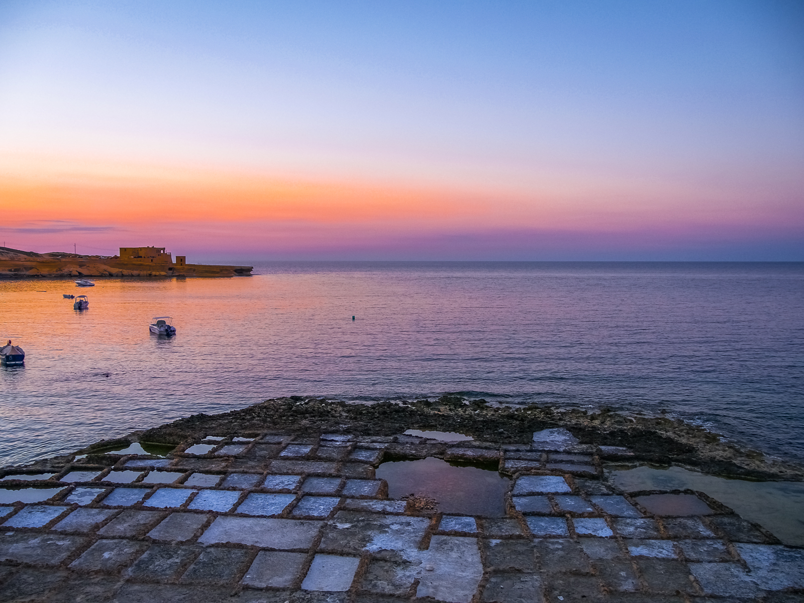 Salt pans at sunset on the island of Gozo, Malta