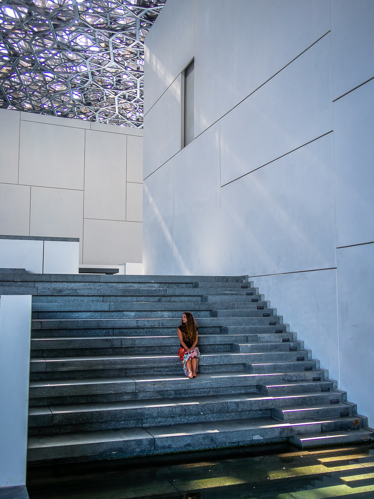 Staircase leading to water in the Louvre Abu Dhabi