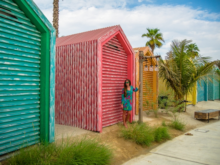 Colorful beach huts on the boardwalk at La Mer