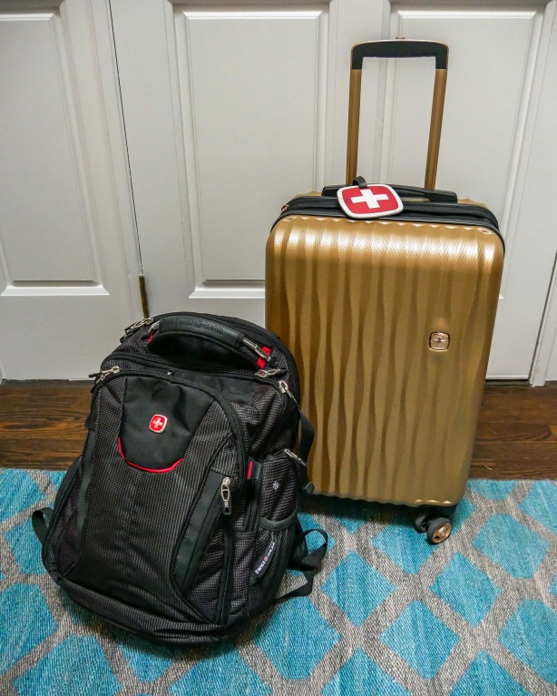 Backpack and rolling carry-on hard shell luggage