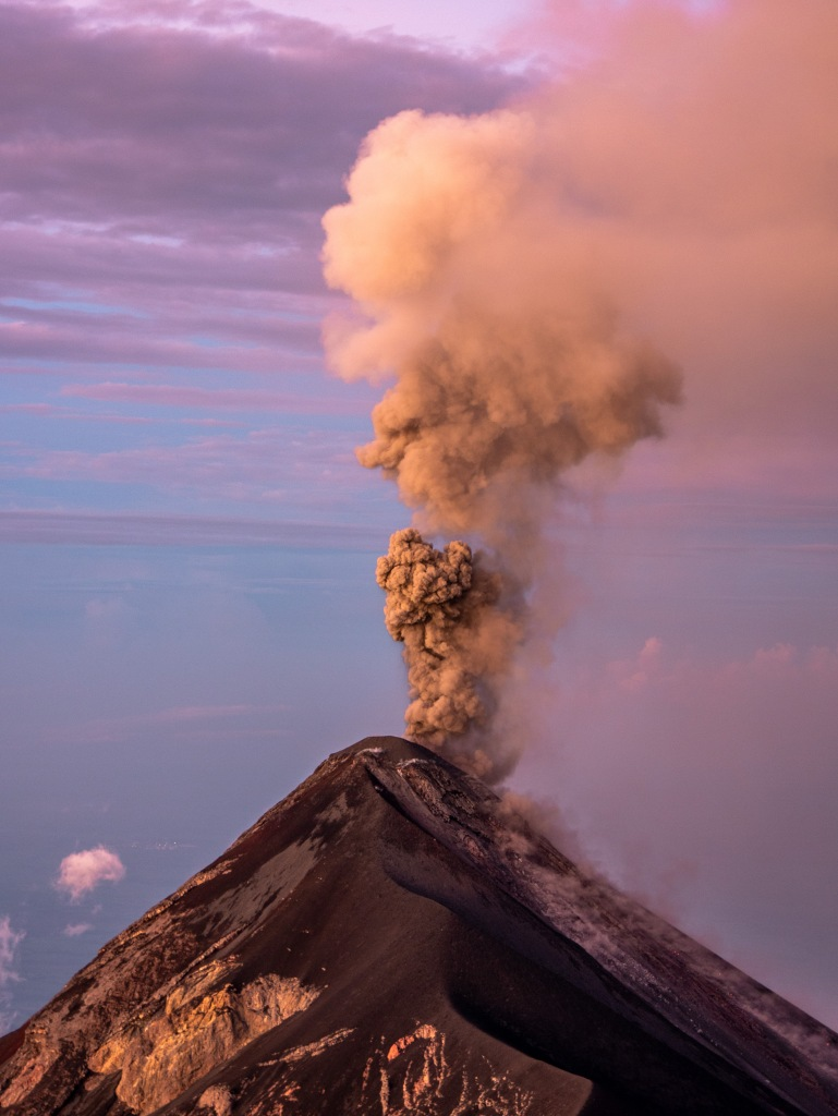 Fuego Volcano erupting at sunrise