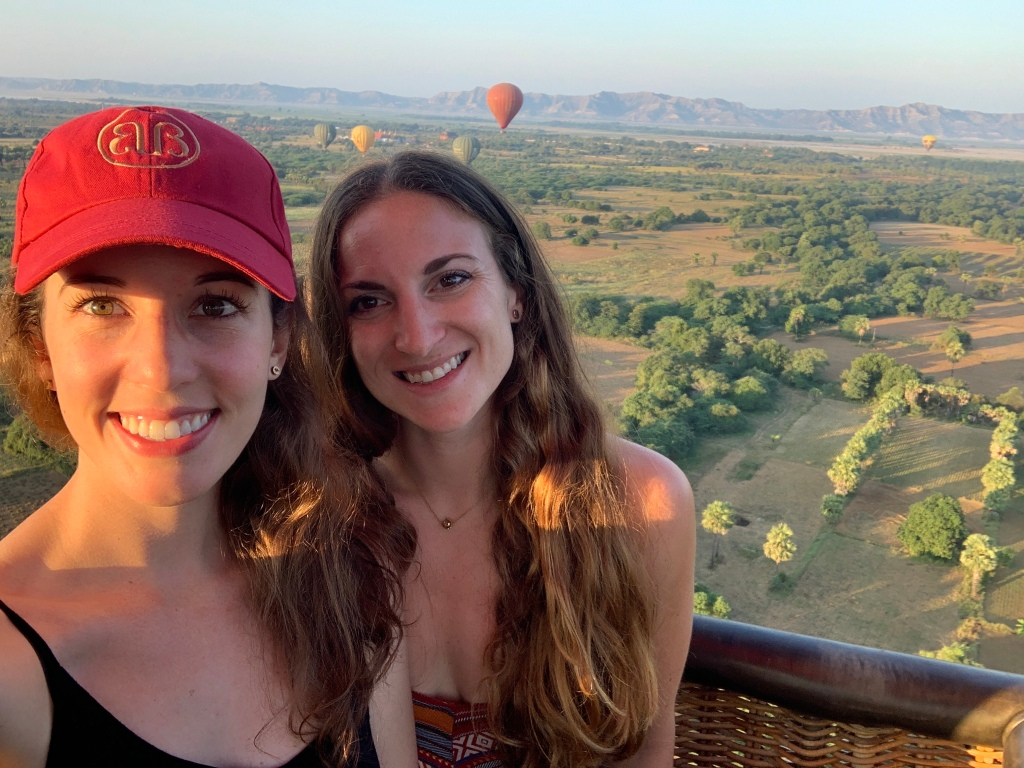 Two brunette travellers in a hot air balloon in Bagan, Myanmar